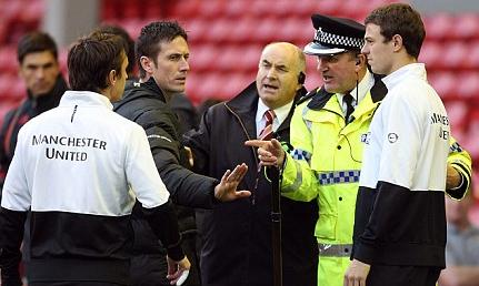 Neville with police at Anfield