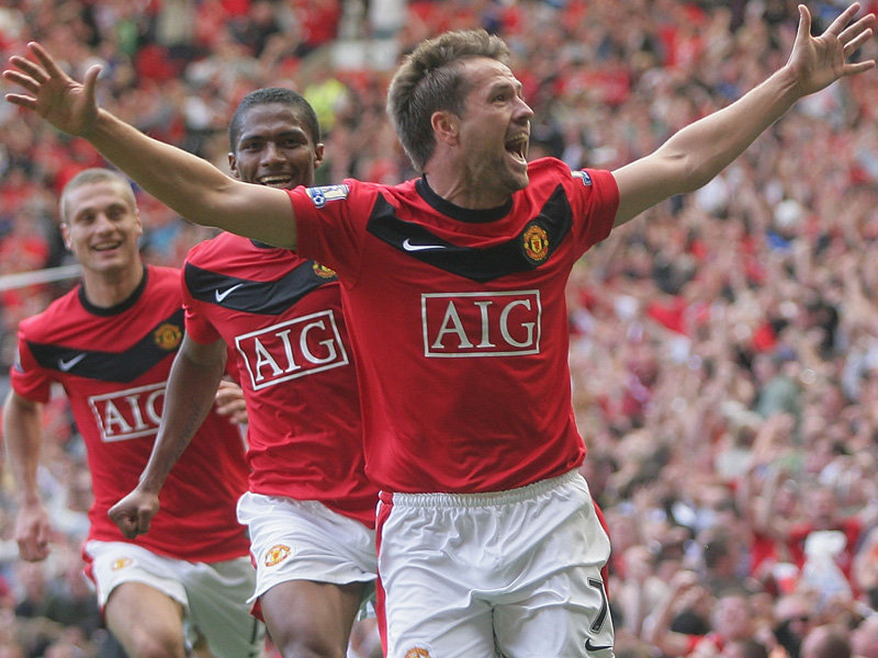 Michael Owen celebrates against City