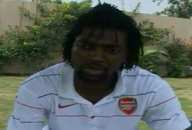 Manchester City's Adebayor wearing an Arsenal t-shirt