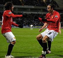 Tevez and Berbatov celebrate