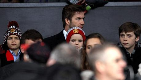 PICTURE: Becks At Football With More Appropriately Dressed Kids