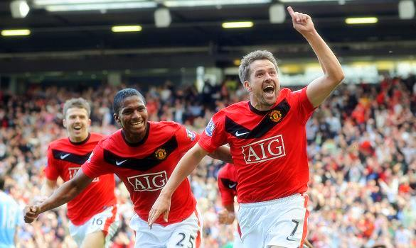 Michael Owen celebrating his late goal against City in 09/10