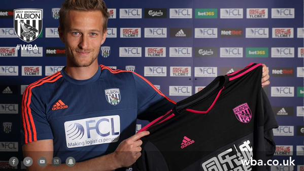 PICTURE: Lindegaard in West Brom shirt after sealing transfer