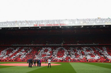 MANCHESTER, ENGLAND - APRIL 03:  Fans show their appreciation as the South Stand is unveiled as the newly renamed Sir Bobby Charlton stand to honour 60 years since his Manchester United debut prior to the Barclays Premier League match between Manchester United and Everton at Old Trafford on April 3, 2016 in Manchester, England.  (Photo by Alex Livesey/Getty Images)
