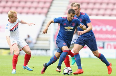 WIGAN, ENGLAND - JULY 16:  Henrikh Mkhitaryan of Manchester United in action during the pre-season friendly match between Wigan Athletic and Manchester United at JJB Stadium on July 16, 2016 in Wigan, England.  (Photo by Matthew Peters/Man Utd via Getty Images)