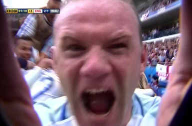 GRABS - Wayne Rooney grabs camera while celebrating Daniel Sturridge's injury time winner. England Vs. Wales Euro 2016