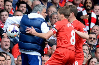 Chelsea's Portuguese manager Jose Mourinho (L) keeps the ball away from Liverpool's English midfielder Steven Gerrard (C) during the English Premier League football match between Liverpool and Chelsea at Anfield Stadium in Liverpool, northwest England, on April 27, 2014. AFP PHOTO / ANDREW YATES  RESTRICTED TO EDITORIAL USE. NO USE WITH UNAUTHORIZED AUDIO, VIDEO, DATA, FIXTURE LISTS, CLUB/LEAGUE LOGOS OR LIVE SERVICES. ONLINE IN-MATCH USE LIMITED TO 45 IMAGES, NO VIDEO EMULATION. NO USE IN BETTING, GAMES OR SINGLE CLUB/LEAGUE/PLAYER PUBLICATIONS        (Photo credit should read ANDREW YATES/AFP/Getty Images)