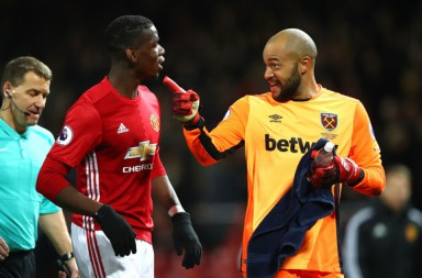 MANCHESTER, ENGLAND - NOVEMBER 27: Paul Pogba of Manchester United (L) and Darren Randolph of West Ham United (R) exchange words while walking in at half time during the Premier League match between Manchester United and West Ham United at Old Trafford on November 27, 2016 in Manchester, England.  (Photo by Clive Brunskill/Getty Images)