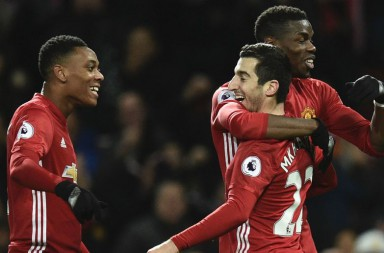 Manchester United's Armenian midfielder Henrikh Mkhitaryan (2R) celebrates scoring their third goal with Manchester United's French midfielder Paul Pogba (R) and Manchester United's French striker Anthony Martial (L) during the English Premier League football match between Manchester United and Sunderland at Old Trafford in Manchester, north west England, on December 26, 2016. / AFP / Oli SCARFF / RESTRICTED TO EDITORIAL USE. No use with unauthorized audio, video, data, fixture lists, club/league logos or 'live' services. Online in-match use limited to 75 images, no video emulation. No use in betting, games or single club/league/player publications.  /         (Photo credit should read OLI SCARFF/AFP/Getty Images)