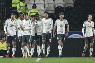 Manchester United's French midfielder Paul Pogba (C) celebrates with teammates afer scoring during the EFL (English Football League) Cup semi-final second-leg football match between Hull City and Manchester United at the KCOM Stadium in Kingston upon Hull, north east England on January 26, 2017.   / AFP / Oli SCARFF / RESTRICTED TO EDITORIAL USE. No use with unauthorized audio, video, data, fixture lists, club/league logos or 'live' services. Online in-match use limited to 75 images, no video emulation. No use in betting, games or single club/league/player publications.  /         (Photo credit should read OLI SCARFF/AFP/Getty Images)