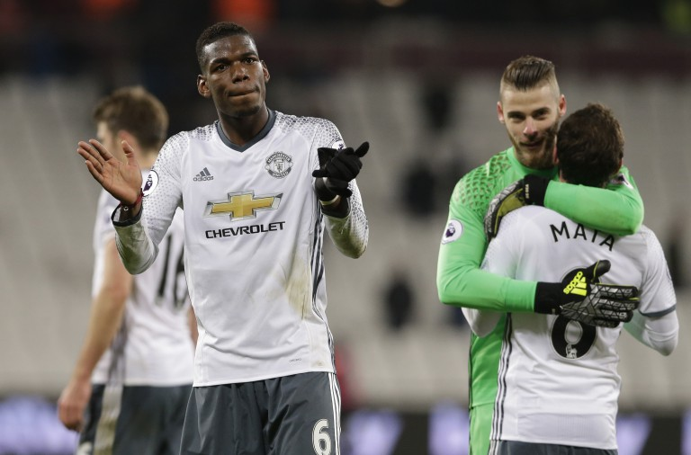 Manchester United's Paul Pogba applauds his teams fans after the end of the English Premier League soccer match between West Ham United and Manchester United at the London stadium, in London Monday, Jan. 2, 2017.United won the game 2-0. (AP Photo/Alastair Grant)