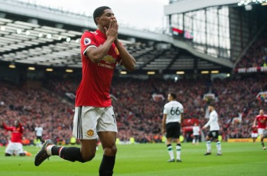 epa06593593 Marcus Rashford of Manchester United  celebrates scoring the second goal during the English Premier League soccer match between Manchester United and Liverpool held at the Old Trafford, Manchester, Britain,  10 March 2018.  EPA/PETER POWELL EDITORIAL USE ONLY. No use with unauthorized audio, video, data, fixture lists, club/league logos or 'live' services. Online in-match use limited to 75 images, no video emulation. No use in betting, games or single club/league/player publications