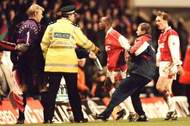 Ian-Wright-is-restrained-by-trainer-Gary-Lewin-from-confronting-Peter-Schmeichel
