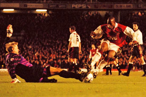 Ian-Wright-tackles-Peter-Schmeichel-with-a-two-footed-challenge