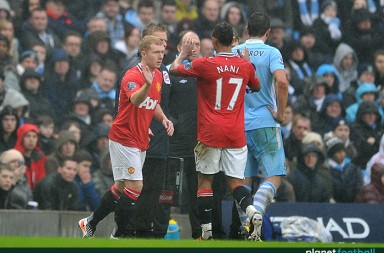 Manchester United's Paul Scholes (Left) is brought on for a substitute for team-mate Luis Nani, on his comeback from retirement for Manchester United