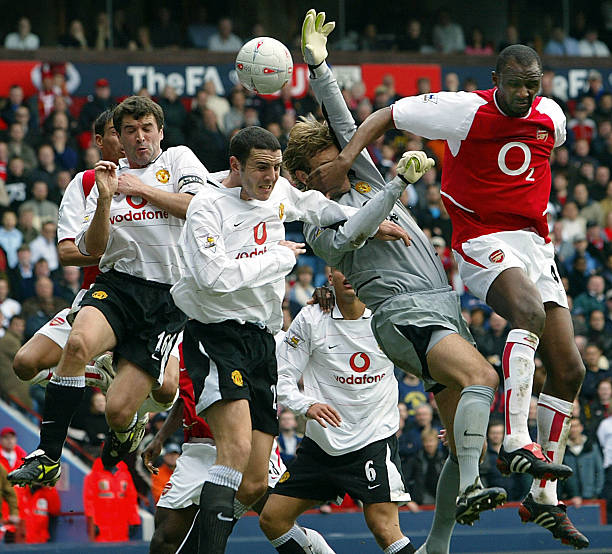 Arsenal's captain Patrick Vieira (R) vies for the ball with goalie Roy Carroll (2ndR), Daren Fletcher (2ndL) and Roy Keane of Manchester United during their FA Cup semi-final clash at Villa park in Birmingham, 03 April 2004. AFP PHOTO / ODD ANDERSEN - - No telcos,website use to description of license with FAPL on, www.faplweb.com - - (Photo credit should read ODD ANDERSEN/AFP/Getty Images)