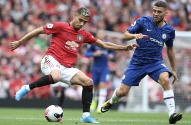 MANCHESTER, ENGLAND - AUGUST 11: Andreas Pereira of Manchester United in action with Mateo Kovacic of Chelsea during the Premier League match between Manchester United and Chelsea FC at Old Trafford on August 11, 2019 in Manchester, United Kingdom. (Photo by Matthew Peters/Manchester United via Getty Images)