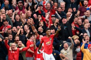 Manchester United's English striker Marcus Rashford celebrates after scoring their third goal during the English Premier League football match between Manchester United and Chelsea at Old Trafford in Manchester, north west England, on August 11, 2019. - Manchester United won the game 4-0. (Photo by Oli SCARFF / AFP) / RESTRICTED TO EDITORIAL USE. No use with unauthorized audio, video, data, fixture lists, club/league logos or 'live' services. Online in-match use limited to 120 images. An additional 40 images may be used in extra time. No video emulation. Social media in-match use limited to 120 images. An additional 40 images may be used in extra time. No use in betting publications, games or single club/league/player publications. /         (Photo credit should read OLI SCARFF/AFP/Getty Images)