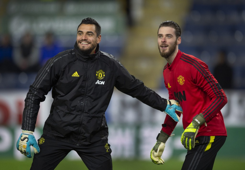 BURNLEY, ENGLAND - DECEMBER 28: Manchester United goalkeepers Sergio Romero and David de Gea warm up before the Premier League match between Burnley FC and Manchester United at Turf Moor on December 28, 2019 in Burnley, United Kingdom. (Photo by Visionhaus)