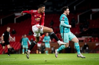 MANCHESTER, ENGLAND - JANUARY 24:   Mason Greenwood of Manchester United scores a goal to make the score 1-1 during the Emirates FA Cup Fourth Round match between Manchester United and Liverpool at Old Trafford on January 24, 2021 in Manchester, England. Sporting stadiums around the UK remain under strict restrictions due to the Coronavirus Pandemic as Government social distancing laws prohibit fans inside venues resulting in games being played behind closed doors. (Photo by Ash Donelon/Manchester United via Getty Images)