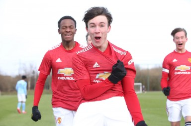 MANCHESTER, ENGLAND - FEBRUARY 13: Charlie McNeill of Manchester United U18s celebrates scoring their first goal during the U18 Premier League match between Manchester United U18s and Manchester City U18s at Aon Training Complex on February 13, 2021 in Manchester, England. (Photo by John Peters/Manchester United via Getty Images)
