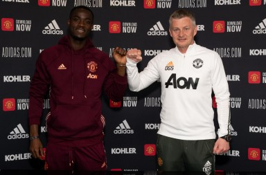 Eric Bailly of Manchester United poses with Ole Gunnar Solskjaer after signing a contract extension at Aon Training Complex on 26 April 2021. Photographer: Ash Donelon