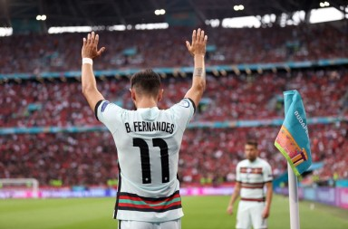 Portugal's midfielder Bruno Fernandes gestures from the corner during the UEFA EURO 2020 Group F football match between Hungary and Portugal at the Puskas Arena in Budapest on June 15, 2021. (Photo by Alex Pantling / POOL / AFP) (Photo by ALEX PANTLING/POOL/AFP via Getty Images)
